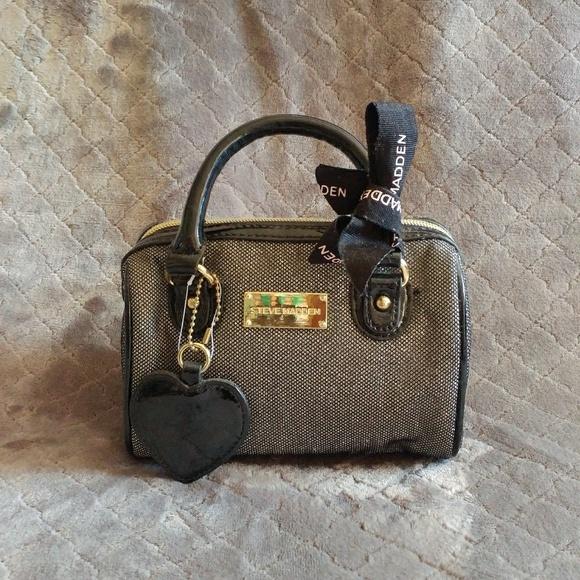 90d40a1480b Steve Madden Mini Silver Boston. M 5c55032c04e33de7ae2c493e